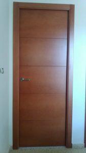 Instalación en Sevilla de puertas con lacado clásico